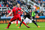 Mohamed Diame (#10) of Newcastle United passes the ball around the challenge of Jonathan Hogg (#6) of Huddersfield Town during the Premier League match between Newcastle United and Huddersfield Town at St. James's Park, Newcastle, England on 31 March 2018. Picture by Craig Doyle.