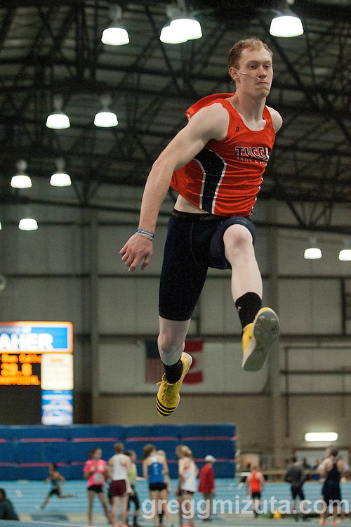 Treasure Valley Community College's Eric England triple jumps during the New Balance Boise Indoor track and field  meet at Idaho Center's Jackson Track, Nampa, Idaho, February 7, 2015. England won the Mens Triple Jump College/Open event with a jump of 15.58m (51-01.50).