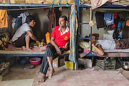 10/10/2014 -- Kirkuk, Iraq -- A portrait of Bangladeshi worker in his bedroom during the two hours break they have in the afternoon.