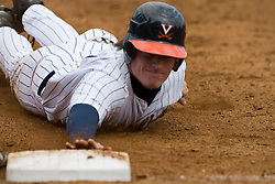 Virginia Cavaliers outfielder Brandon Marsh (9) dives back to first base to beat a Duke pickoff attempt.  The Virginia Cavaliers Baseball team defeated the Duke Blue Devils 8-1 in the final game of a three game series at Davenport Field in Charlottesville, VA on April 8, 2007. The win secured a 2-1 series victory over the Blue Devils.