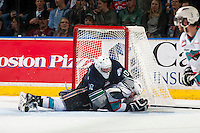 KELOWNA, CANADA - APRIL 22: Tyson Baillie #24 of Kelowna Rockets falls into the net of Landon Bow #30 of Seattle Thunderbirds on April 22, 2016 at Prospera Place in Kelowna, British Columbia, Canada.  (Photo by Marissa Baecker/Shoot the Breeze)  *** Local Caption *** Tyson Baillie; Landon Bow;