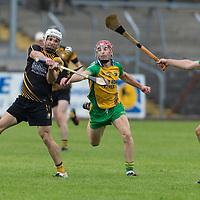 Clonlara's Domhnall O'Donovan is put under pressure from Inagh Kilnamona's Stephen Foudy and Cian McInerney