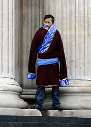 © Licensed to London News Pictures. 14/05/2012. City of London, UK A man waits on the steps.The Dalai Lama arrives at St Paul's Cathedral today 14 may 2012 to be presented with the £1.1m Templeton annual prize in his first visit to the Cathedral. The award is for a living person who has 'made an exceptional contribution to affirming the spiritual dimension of life'.. Photo credit : Stephen Simpson/LNP