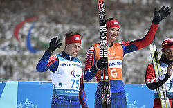 March 17, 2018 - Pyeongchang, South Korea - Jake Adicoff of the US and guide Sawyer Kesselheim celebrate their silver medal finish in the 10km Cross Country event Saturday, March 17, 2018 at the Alpensia Biathlon Center at the Pyeongchang Winter Paralympic Games. Photo by Mark Reis (Credit Image: © Mark Reis via ZUMA Wire)
