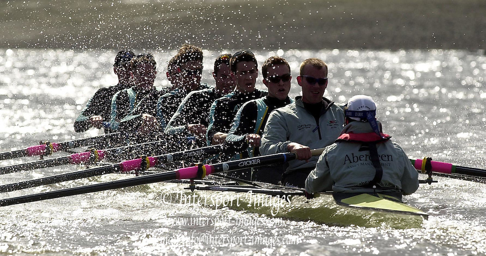 © Peter Spurrier / Intersport images.email images@Intersport.co.uk - Tel +44 208 876 8611.2003 - Rowing - 149th Varsity Boat Race - Tideway Week .02/04/03 - Photo Peter Spurrier.Cambridge Blue Boat  - Morning training session.Crew -  Bow Wayne Pommen, 2. Kris Coventry,  3. Hugo Mallinson, 4. Matthias Kleinz, 5.  Alex McGarel-Groves, 6. Tom James, 7. James Livingstone,  stroke Tim Wooge president. cox  Jim Omartian Varsity Boat Race [Mandatory Credit: Peter Spurrier; Intersport Images.]