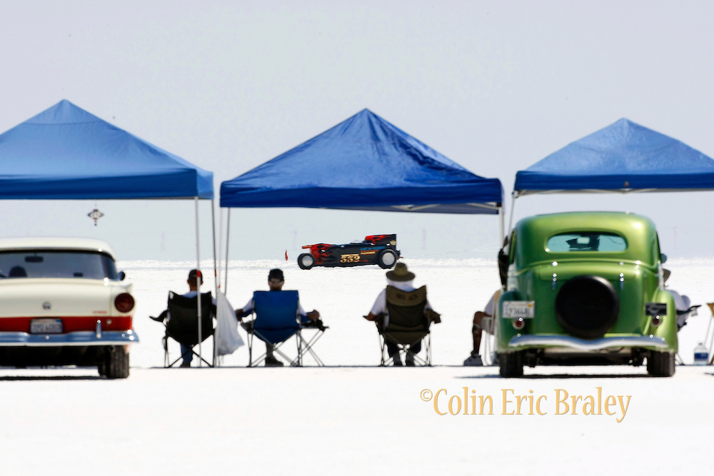 The best cars-people-atmosphere-photos of 2009 Bonneville Speed Week- Fans take shelter from the heat as they watch the speed trials under canopies at the Bonneville Speed Way. August 9, 2009.  Photo by Colin E. Braley
