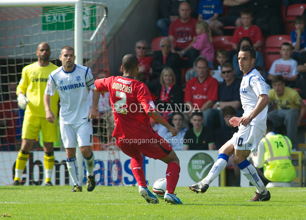 LONDON, ENGLAND - Saturday, April 30, 2011: Tranmere Rovers' Robbie Weir clears the ball away from Leyton Orient's Elliot Omozusi  during the Football League One match at Brisbane Road. (Photo by Gareth Davies/Propaganda)