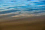 bright aqua and tan colors of water ripples off the pacific ocean create a feeling of freeness and lightness