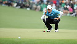 April 7, 2018 - Augusta, GA, USA - Rory Mcllroy lines up a birdie putt on the 15th green during the third round of the Masters Tournament on Saturday, April 7, 2018, at Augusta National Golf Club in Augusta, Ga. (Credit Image: © Jason Getz/TNS via ZUMA Wire)