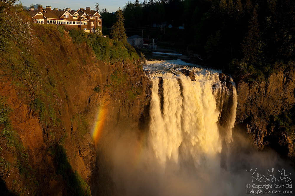 A rainbow forms in the spray of Snoqualime Falls, a 268 ft (82 m) waterfall located on the Snoqualmie River in Snoqualmie, Washington. The Salish Lodge and Spa stands on the cliff. The original lodge was built in 1919 and completely remodeled in 1988. The fireplace is the only remaining part of the original structure.
