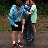 LIBBY EZELL | BUY AT PHOTOS.DJOURNAL.COM<br /> Anders Caldwell, 13, of Shockwave helps pick up trash Saturday at Veteran's Park