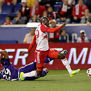 HARRISON, NEW JERSEY- APRIL 24: Bradley Wright-Phillips, (right), #99 of New York Red Bulls, is tackled by Tommy Redding #29 of Orlando City FC during the New York Red Bulls Vs Orlando City MLS regular season match at Red Bull Arena, Harrison, New Jersey on April 24, 2016 in New York City. (Photo by Tim Clayton/Corbis via Getty Images)