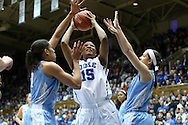 03 March 2013: Duke's Richa Jackson (15) is defended by North Carolina's Krista Gross (left) and Megan Buckland (right). The Duke University Blue Devils played the University of North Carolina Tar Heels at Cameron Indoor Stadium in Durham, North Carolina in a 2012-2013 NCAA Division I and Atlantic Coast Conference women's college basketball game. Duke won the game 65-58.