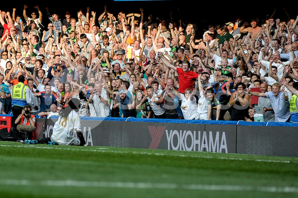 Bafetibis Gomis of Swansea City celebrates his goal during the Barclays Premier League match between Chelsea and Swansea City at Stamford Bridge, London, England on 8 August 2015. Photo by Salvio Calabrese.