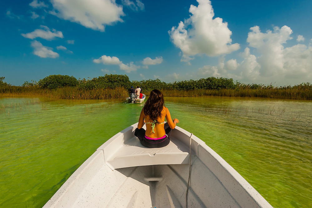 Boating (in a ponga) across the Sian Ka'an Biosphere Reserve, in Riviera Maya, Mexico, which is a small ecotourism and education center, it serves as a model for sustainable development in sensitive tropical ecosystems. It is a UNICEF World Heritage Site and is the third largest natural protected area in Mexico.