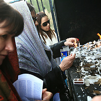 Young women light candles as they pray at the grave of Yonatan ben Uziel at Amukah in the Galilee in Israel.Over the centuries the tradition developed that those seeking for their soul-mates would be married within one year if they prayed at Rabbi Ben-Uziel's tomb.