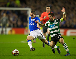 LIVERPOOL, ENGLAND - Tuesday, February 16, 2010: Everton's Leon Osman and Sporting Clube de Portugal's Joao Moutinho during the UEFA Europa League Round of 32 1st Leg match at Goodison Park. (Photo by: David Rawcliffe/Propaganda)