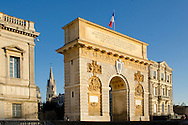 The Porte du Peyrou is a triumphal arch in Montpellier, in southern France. It is situated at the eastern end of the Jardin de Peyrou, an esplanade the centre of the city. The arch was designed by François Dorbay and is crowned by a Doric entablature, suitable to a martial monument. Its later panels in bas-relief and inscriptions glorifying King Louis XIV of France were added in 1715.