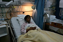 UK ENGLAND LONDON 8JUL05 - Cythia Bobb-Semple (43) is being interviewed at her hospital bed at St. Mary's hospital in Paddington, West London. She is an eyewitness to the train bombing at Edware Road and was in the carriage next to the blast. At least 37 people have been killed and hundreds injured after four blasts on the Underground network and a double-decker bus in London. Full interview available by Pool at Press Association...jre/Photo by POOL