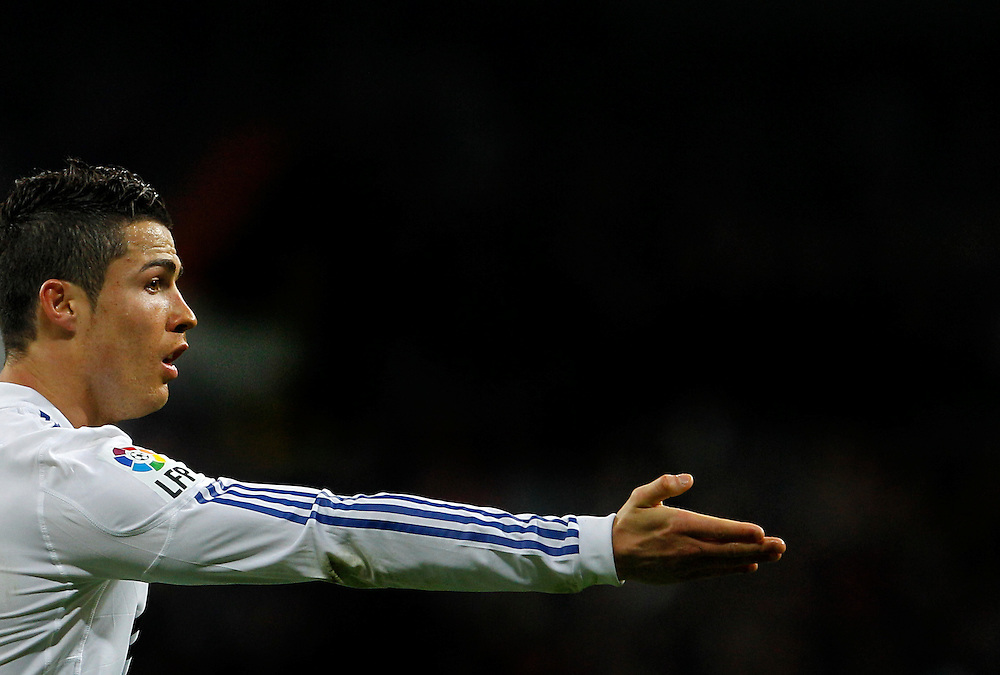 Real Madrid's Cristiano Ronaldo from Portugal, reacts during his Spanish La Liga soccer match against Sevilla at the Santiago Bernabeu stadium in Madrid, Sunday, Dec. 19, 2010.