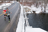 Mamakating, New York - Runners compete in the Wurtsboro Mountain 30K road race on March 21, 2015.