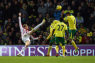 Picture by Paul Chesterton/Focus Images Ltd +44 7904 640267.03/11/2012.Peter Crouch of Stoke has an acrobatic shot on goal during the Barclays Premier League match at Carrow Road, Norwich.