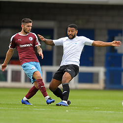 TELFORD COPYRIGHT MIKE SHERIDAN Liam Agnew of Gateshead and Ellis Deeney of Telford during the National League North fixture between AFC Telford United and Gateshead FC at the New Bucks Head Stadium on Saturday, August 10, 2019<br /> <br /> Picture credit: Mike Sheridan<br /> <br /> MS201920-005