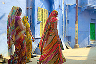 Women on colorful saris at the backstreets of Bundi