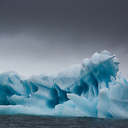 An iceberg sculpted by the polar winds. As we approached the North pole in the polar summer of 2017 we were surprised at just how thin the sea ice was and it certainly was no problem for the Russian Ice breaker 50 Year of Victory.<br /> Cover feature, Washington Post magazine