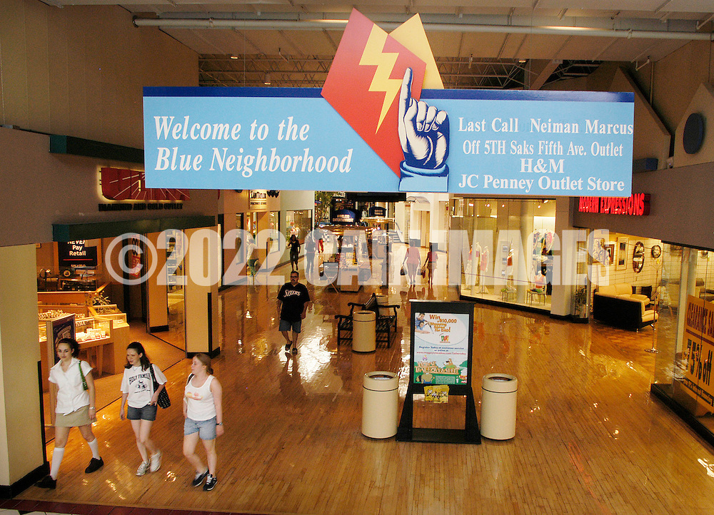 PHILADELPHIA, PA - JUNE 15:  A sign at Franklin Mills Mall directs shoppers to the Blue Neighborhood June 15, 2005 in Philadelphia, Pennsylvania. (Photo by William Thomas Cain)