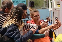 May 11, 2017 - Madrid, Spain - SIMONA HALEP of Romania with fans after winning her quarterfinal doubles match with I. Begu in the Mutua Madrid Open tennis tournament. (Credit Image: © Christopher Levy via ZUMA Wire)