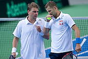 (L) Marcin Matkowski &amp; (R) Mariusz Fyrstenberg both from Poland compete in double match during the BNP Paribas Davis Cup 2014 between Poland and Croatia at Torwar Hall in Warsaw on April 5, 2014.<br /> <br /> Poland, Warsaw, April 5, 2014<br /> <br /> Picture also available in RAW (NEF) or TIFF format on special request.<br /> <br /> For editorial use only. Any commercial or promotional use requires permission.<br /> <br /> Mandatory credit:<br /> Photo by &copy; Adam Nurkiewicz / Mediasport