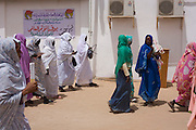 Ladies attending the first-ever international Conference on Womens' Challenge in Darfur, leave the venue during a break in procedings in a compound belonging to the Govenor of North Darfur in Al Fasher (also spelled, Al-Fashir) where the women from remote parts of Sudan gathered to discuss peace and political issues.