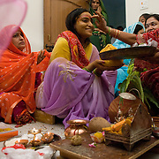 applying the Roli (sindur) A Rajput wedding in India