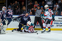 KELOWNA, CANADA - JANUARY 3: Carsen Twarynski #18 of the Kelowna Rockets falls to the ice after scoring a goal and colliding with Roman Kalinichenko #4 of the Tri-City Americans on January 3, 2017 at Prospera Place in Kelowna, British Columbia, Canada.  (Photo by Marissa Baecker/Shoot the Breeze)  *** Local Caption ***