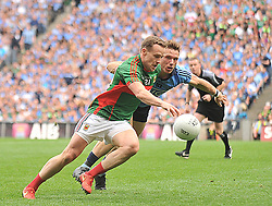 Mayo's Andy Moran and Dublin's Paul Flynn compete for posession during the closing stages of the All Ireland semi-final in Croke park on sunday last.<br /> Pic Conor McKeown