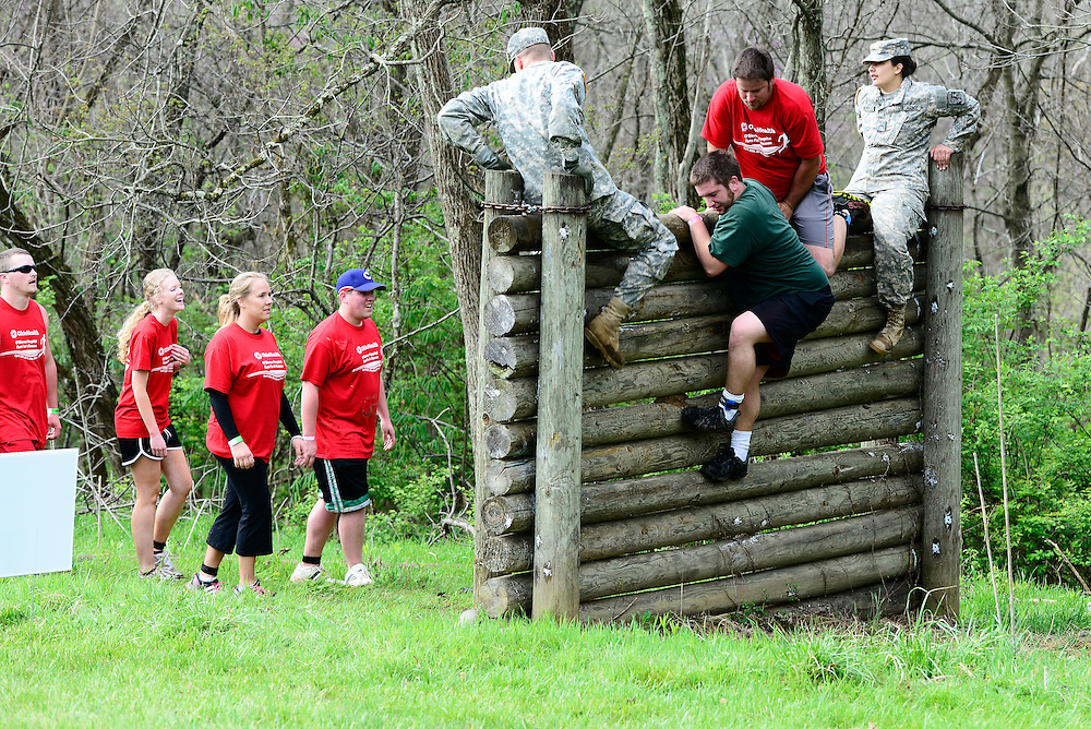 Participants scale a wall during the Mud Run on Saturday morning, April 26, 2014. The Mud Run is hosted by Ohio Health O'Bleness Hospital Race for a Reason. Photo by Olivia Wallace