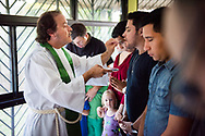 The Rev. Dr. Jonathan Naumann, LCMS missionary to the Dominican Republic, distributes the sacrament to Seminarian Guillermo Leyva during worship at the LCMS Latin America regional office in Santiago, Dominican Republic, on Tuesday, Oct. 17, 2017. LCMS Communications/Erik M. Lunsford