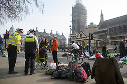 © Licensed to London News Pictures. 18/04/2019. London, UK. Extinction Rebellion campaigners occupy Parliament Square in London on a fourth day of protests by the group. Protesters are demanding urgent government action on climate change. Photo credit: Ben Cawthra/LNP
