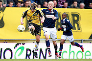 Onderwerp/Subject: NAC Breda - Willem II - Eredivisie<br /> Reklame:  <br /> Club/Team/Country: <br /> Seizoen/Season: 2012/2013<br /> FOTO/PHOTO: Tim GILISSEN (L) of NAC Breda wearing a protective mask in duel with Danny GUIJT (R) of Willem II. (Photo by PICS UNITED)<br /> <br /> Trefwoorden/Keywords: <br /> #04 #06 $94 &plusmn;1355238527106<br /> Photo- &amp; Copyrights &copy; PICS UNITED <br /> P.O. Box 7164 - 5605 BE  EINDHOVEN (THE NETHERLANDS) <br /> Phone +31 (0)40 296 28 00 <br /> Fax +31 (0) 40 248 47 43 <br /> http://www.pics-united.com <br /> e-mail : sales@pics-united.com (If you would like to raise any issues regarding any aspects of products / service of PICS UNITED) or <br /> e-mail : sales@pics-united.com   <br /> <br /> ATTENTIE: <br /> Publicatie ook bij aanbieding door derden is slechts toegestaan na verkregen toestemming van Pics United. <br /> VOLLEDIGE NAAMSVERMELDING IS VERPLICHT! (&copy; PICS UNITED/Naam Fotograaf, zie veld 4 van de bestandsinfo 'credits') <br /> ATTENTION:  <br /> &copy; Pics United. Reproduction/publication of this photo by any parties is only permitted after authorisation is sought and obtained from  PICS UNITED- THE NETHERLANDS