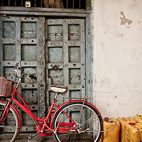 Bike, gerry cans and door in Stonetown, Zanzibar