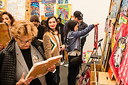 New York, NY - May 3, 2019. Painter Steve Keene at the P.P.O.W. gallery at the Frieze Art Fair on New York City's Randalls Island. Keene was producing multiple paintings at the show, and was selling them at prices starting at $10.
