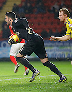Charlton Athletic goalkeeper Stephen Henderson claims the ball and is instantly looking for options during the Sky Bet Championship match between Charlton Athletic and Nottingham Forest at The Valley, London, England on 2 January 2016. Photo by Andy Walter.