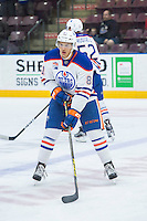PENTICTON, CANADA - SEPTEMBER 16: Caleb Jones #81 of Edmonton Oilers warms up with the puck against the Vancouver Canucks on September 16, 2016 at the South Okanagan Event Centre in Penticton, British Columbia, Canada.  (Photo by Marissa Baecker/Shoot the Breeze)  *** Local Caption *** Caleb Jones;
