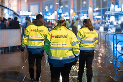 "© Licensed to London News Pictures . 23/12/2017. Manchester, UK. A welfare patrol on Withy Grove by the Printworks . Revellers out in Manchester City Centre overnight during "" Mad Friday "" , named for being one of the busiest nights of the year for the emergency services in the UK . Photo credit: Joel Goodman/LNP"