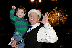 © under license to London News Pictures.  19.11.2010, Mr Tumble (Justin Flecter, MBE) from CBBC.switching the xmas lights on at the winter gardens,Bluewater,Greenhithe,.Kent. with Sam Meads age 2 from Kent..Picture credit should read Grant Falvey/London News Pictures