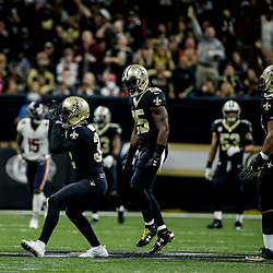 Oct 29, 2017; New Orleans, LA, USA; New Orleans Saints safety Kenny Vaccaro (32) celebrates with safety Rafael Bush (25) after a defensive stop against the Chicago Bears during the first half of a game at the Mercedes-Benz Superdome. The Saints defeated the Bears 20-12. Mandatory Credit: Derick E. Hingle-USA TODAY Sports