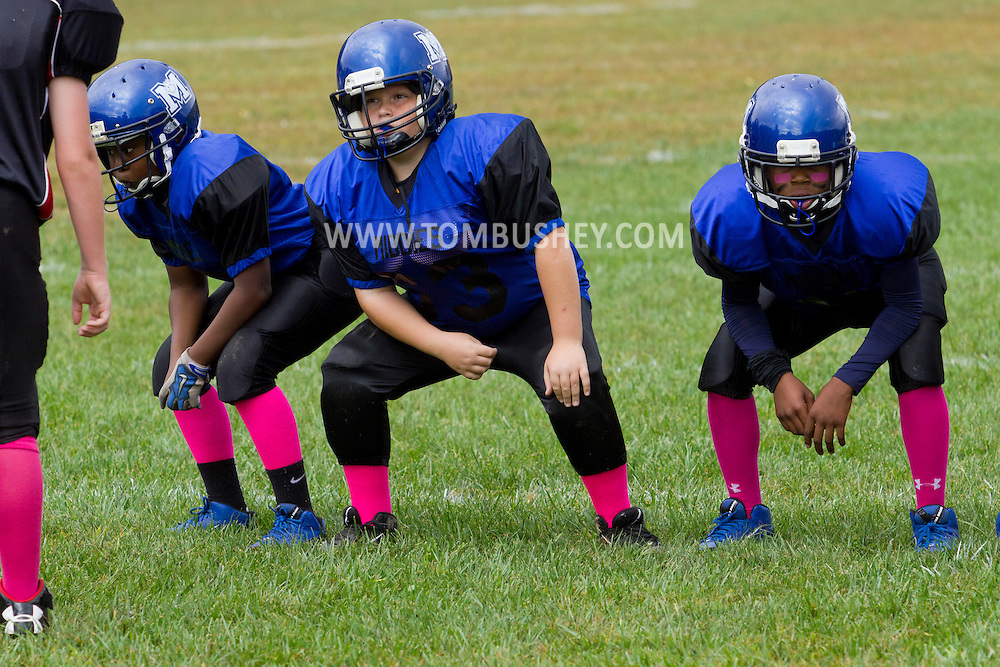 Huguenot, New York - Middletown players line up against Port Jervis in an Orange County Youth Football League Division II game on Oct. 4. 2014.