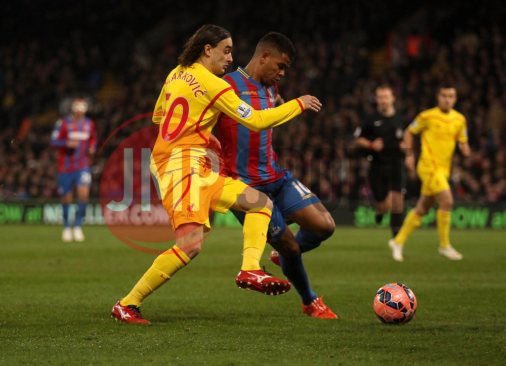 Crystal Palace's Fraizer Campbell and Liverpool's Lazar Markovic battle - Photo mandatory by-line: Robbie Stephenson/JMP - Mobile: 07966 386802 - 14/02/2015 - SPORT - Football - London - Selhurst Park - Crystal Palace v Liverpool - FA Cup - Fifth Round