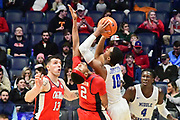 Middle Tennessee Blue Raiders guard Jayce Johnson (10) shoots against Mississippi Rebels guard Devontae Shuler (2) during the second half of an NCAA college basketball game in Nashville, Tenn., Friday, Dec. 21, 2018. (Jim Brown/Image of Sport)